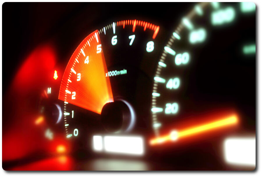 Dashboard of a cars gauges showing acceleration